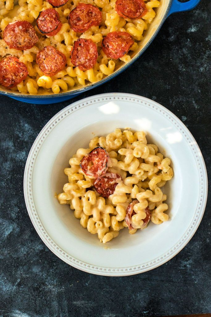 overhead shot of roasted tomato mac and cheese in a bowl