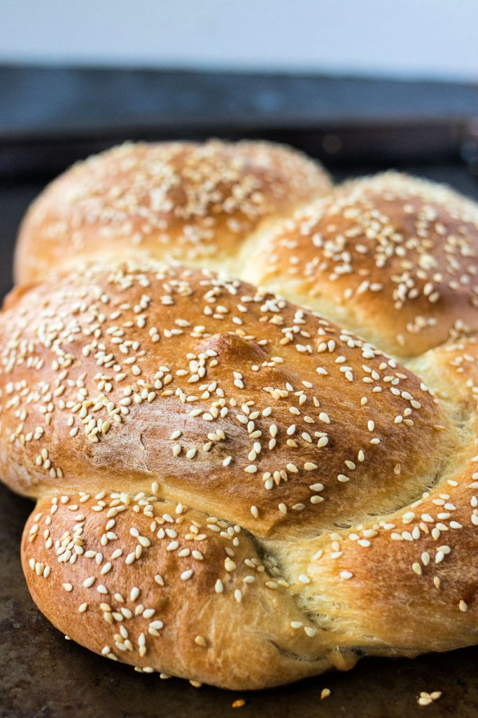 close up of whole loaf of sesame seed braided bread