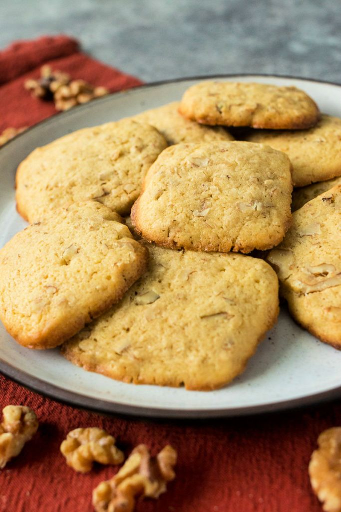 front shot of maple walnut cookies sitting on a plate