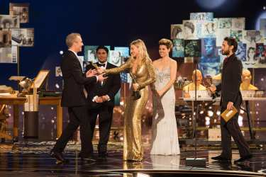 """Presenter Margot Robbies, alongside Jared Leto, gives Damian Martin his Oscar® as he accepts the Oscar® for Achievement in makeup, for work on """"Mad Max: Fury Road"""" during the live ABC Telecast of The 88th Oscars® at the Dolby® Theatre in Hollywood, CA on Sunday, February 28, 2016."""