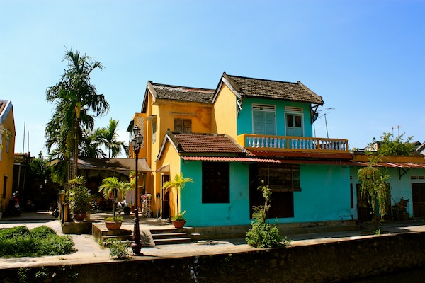 Turquoise and yellow house with balcony in Hoi An, Vietnam