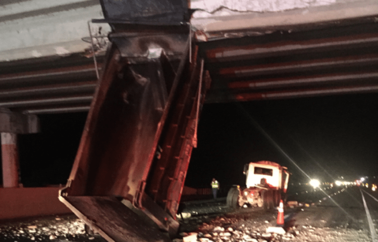 Dump Truck Crashes Into Overpass Causing Traffic Backup on I