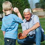 Vision loss: grandfather playing baseball with grandson.