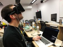 Andrew Ellem shows off his creation with the Oculus Rift