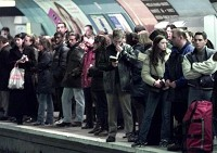 PARIS COMMUTERS IN METRO STATION WAIT FOR SUBWAY TRAINS DURING TRANSPORT STRIKE.