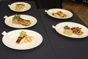 Salmon entrées prepared by young chef competitors