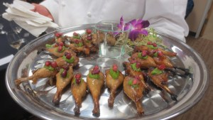 Pomegranate glazed quail drumsticks with arugula and pine nut purée
