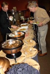 Chargé de Presse Provincial Midwest J.T. Mayer at buffet