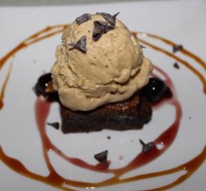Warm olive oil brownie with bourbon semi-freddo and Amarena cherries