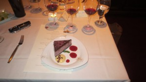 Raspberry chocolate cheesecake cake with espresso crème anglaise, chocolate sauce, and raspberry coulis