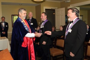 Vice Echanson Mike Monnin offered Rockwell-Brown red wine to Chevalier Bob Dahlhausen for Mondiale induction ceremony