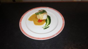 Butter poached market fresh whitefish, three preparations of fresh basil, heirloom tomato, and tomato sorbet