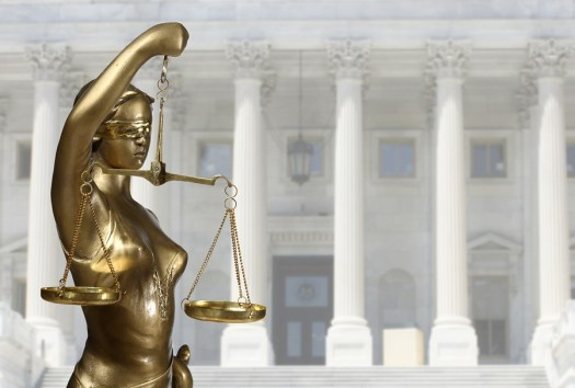 bigstock-Justice-statue-is-on-against-t-52025122