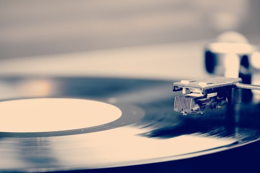 Spinning Vinyl Record. Motion Blur Image. Vintage Toned.