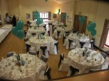 The main hall hosting a wedding reception - Back view