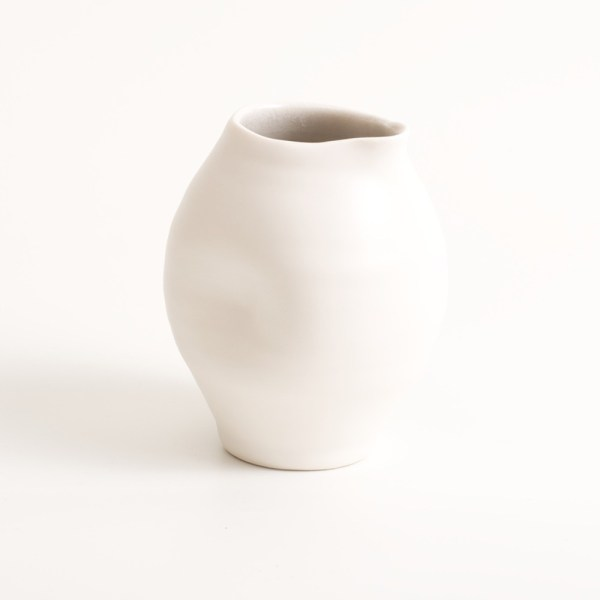 Handmade porcelain dimpled jug small grey. With a matt white glaze on the outside and soft coloured inside. Available in white, grey and turquoise, in two sizes. Perfectly formed dimples to fit in your hand. Handmade by Linda Bloomfield in London. Sold on chalkandmoss.com.