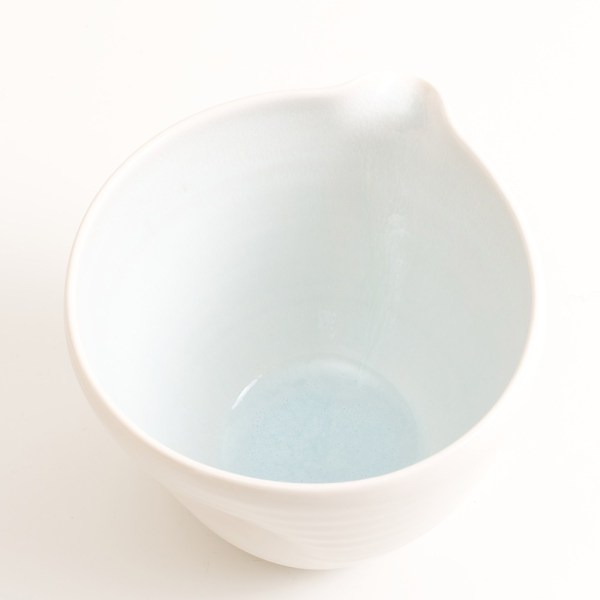 Handmade porcelain pouring bowl medium pale blue inside with tactile dimples. Small or medium size. Inside glazed in a choice of: pale blue, turquoise, pink or grey.