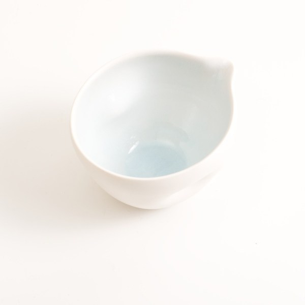 Handmade porcelain pouring bowl small baby blue inside. Small or medium size with tactile dimples instead of handles. Inside glazed in pale blue, turquoise, pink or grey.