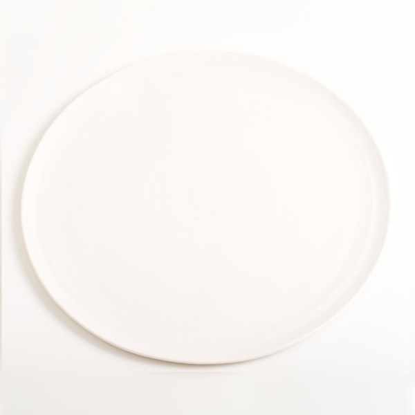 Handmade porcelain plate white. Made in 3 sizes 5 colours. Hand thrown in England, dishwasher safe. These look great as part of a mix and match set. For every day dining and entertaining.