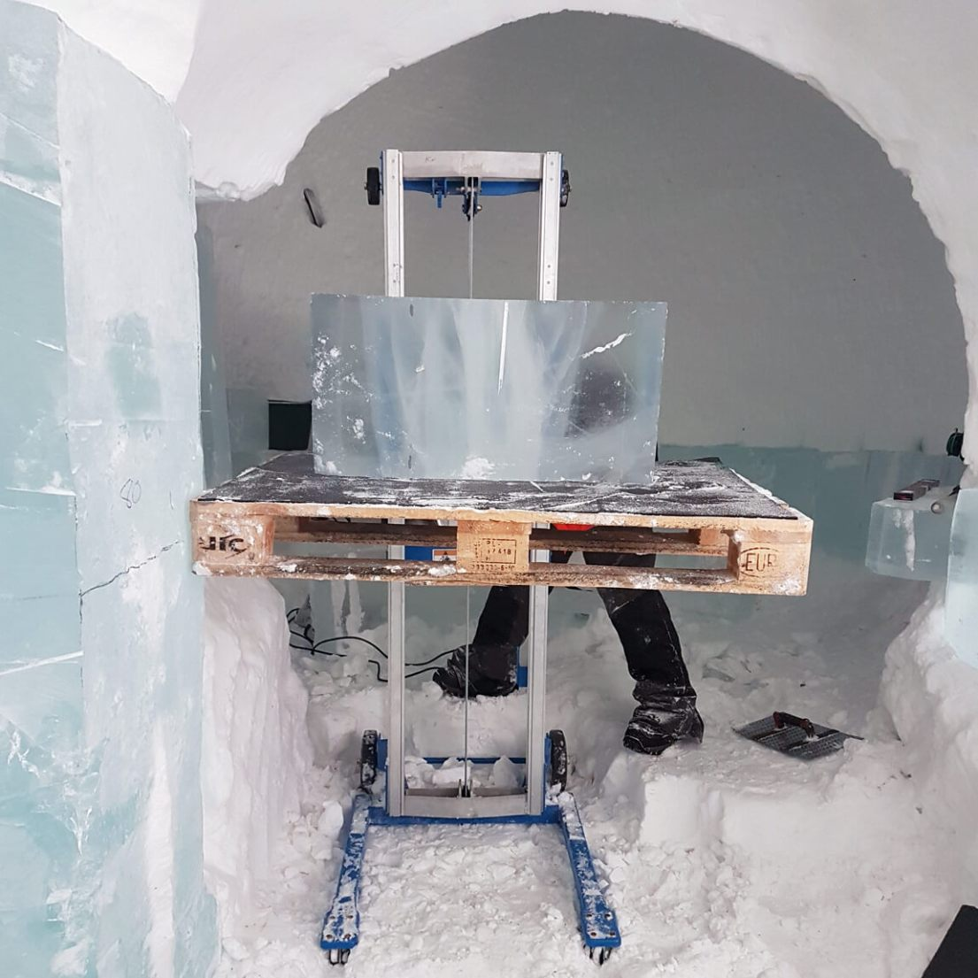 Building the ICEHOTEL - special equipment is needed to lift heavy ice blocks to construct the walls