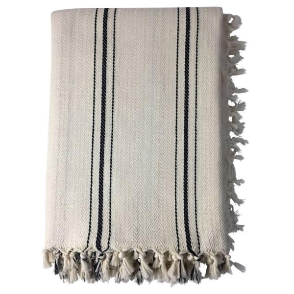 Enes oversized herringbone blanket. Neutral cream with black stripes. Hand loomed in 100% cotton, 240 x 200cm.