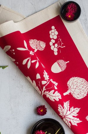 Cotton napkins in a winter botanical leaf print - 4 vibrant colours available, here shown in poppy red. Designed by Softer + Wild, hand screen printed in Sussex, UK. Sold on Chalk & Moss (chalkandmoss.com).