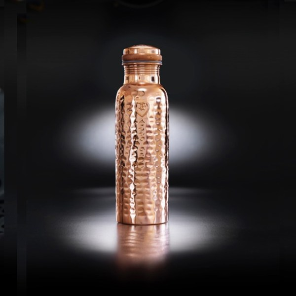 """Copper water bottle with health benefits including antioxidant, anti-inflammatory and anti-microbial properties. The Yogibeings bottles on chalkandmoss.com come in different variations, this one is the polished hammered copper """"Athlete"""" bottle (850ml)."""