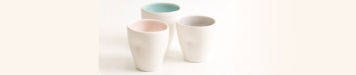 Linda Bloomfield hand throws her porcelain tableware and home accessories in her West London studio. The pieces are silky, tactile and often show a small pool of colour at the base, from the hand made glazes.