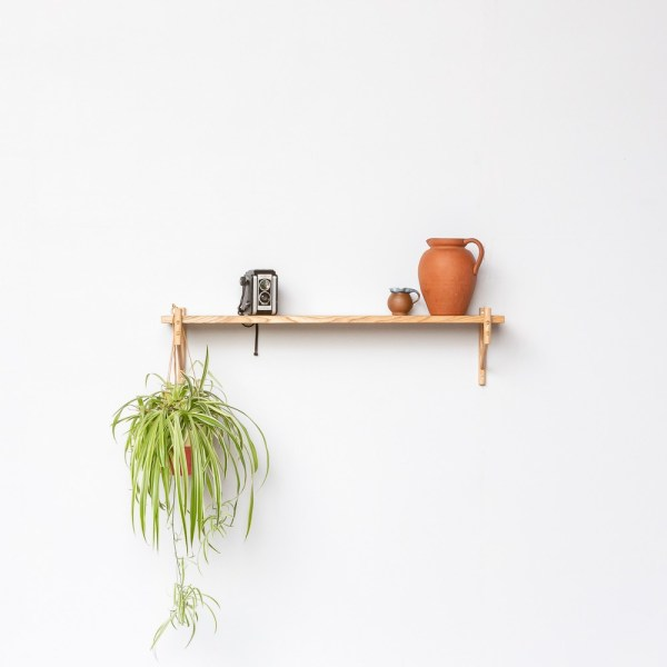 The versatile and modular shelving by John Eadon can be configured in endless ways. This single rung shelf is beautifully used as to hang a plant and display memorabilia and trinkets. It also makes a lovely wall hung book shelf. Whilst handmade in the UK, the simplicity of this furniture gives it a Scandi furniture design aesthetic.