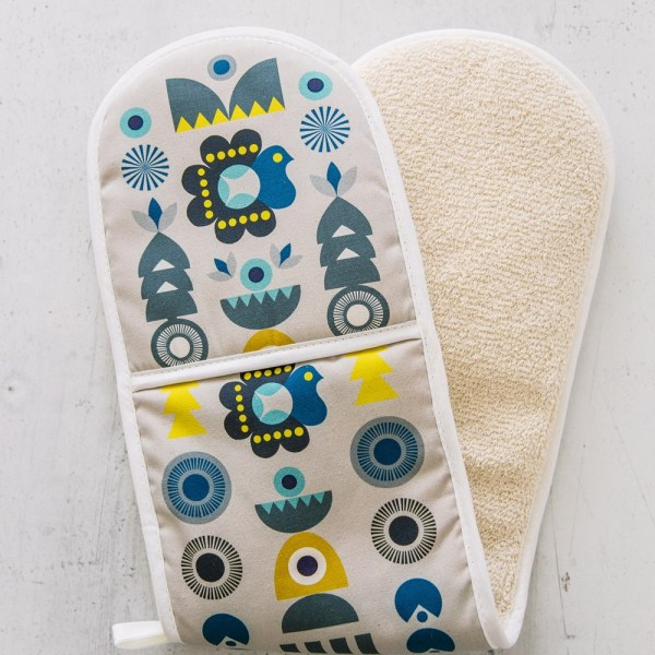 """Solstice double oven glove inspired by Scandinavian 1970s shapes and Eastern European patterns. 84x20cm. 100% cotton with towelling back, heat resistant. Available in two colour ways. This is the """"Winter Solstice"""" design."""