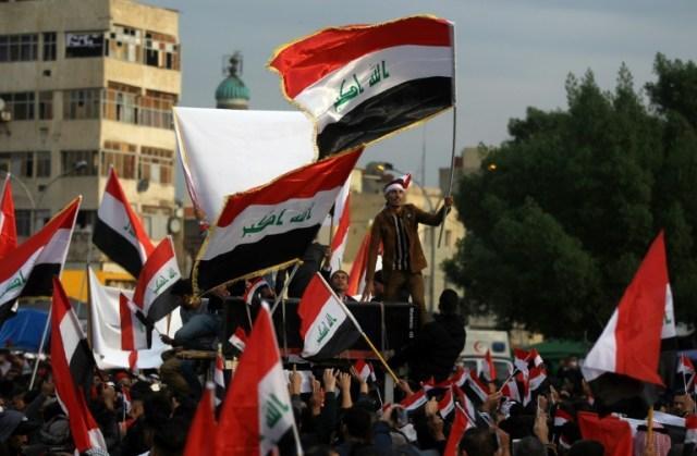 Des Irakiens manifestent sur la place Tahrir à Bagdad, le 6 décembre 2019 (AFP - AHMAD AL-RUBAYE)