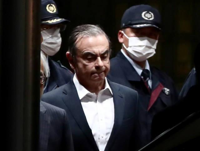 Carlos Ghosn quitte le centre de détention de Tokyo après sa libération sous caution, le 25 avril 2019 (AFP/Archives - Behrouz MEHRI)