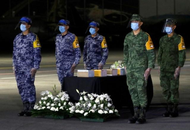 Cérémonie pour le rapatriement des cendres de quelque 200 Mexicains morts du Covid-19 aux Etats-Unis, le 11 juillet 2020 à Mexico  (AFP - Claudio CRUZ)