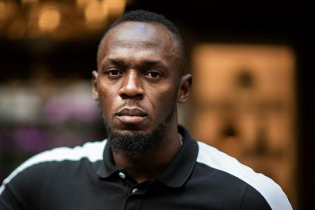 """Usain Bolt le 15 mai 2019 lors d'une séance photo pour le lancement d'une marque de scooters baptisée """"Bolt"""" à Paris (AFP/Archives - Martin BUREAU)"""