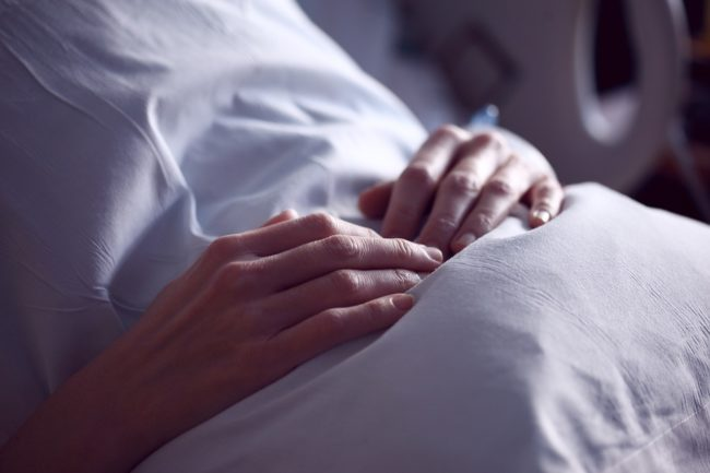 patient in bed recovering from surgery