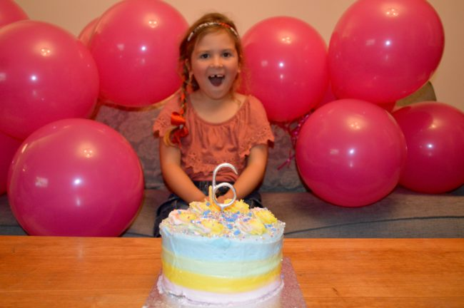 pink balloons and birthday cake