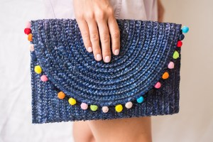 Bohemian Summer Clutch Held By Manicured Hand