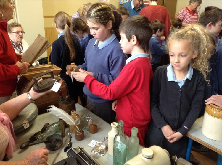 The Way We Were - Children Exploring Older Artefacts At Event in The Burren