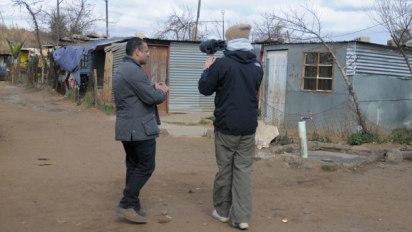 Krishnan Guru Murthy being filmed by Director Alex Nott in Kliptown