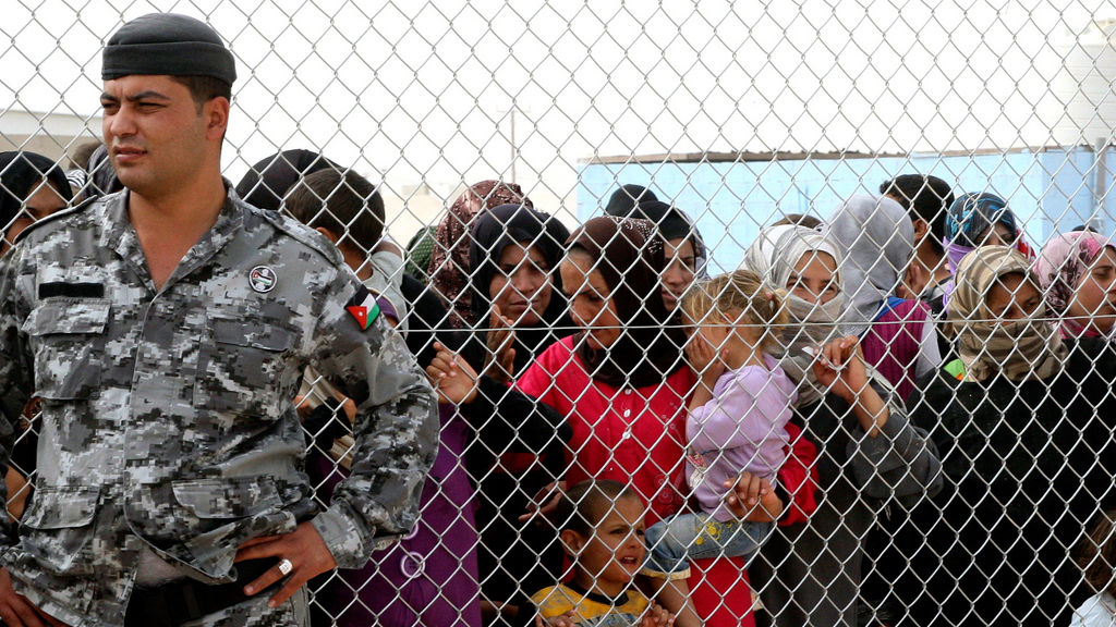 Thousands flee Syria overnight as Assad vows to stay