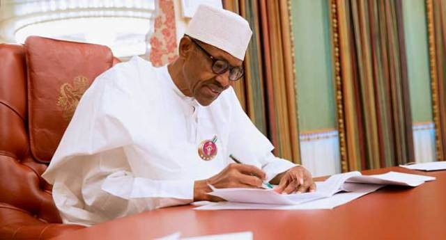 Buhari Signs Senior Citizens Center Bill, Seven Others Into Law