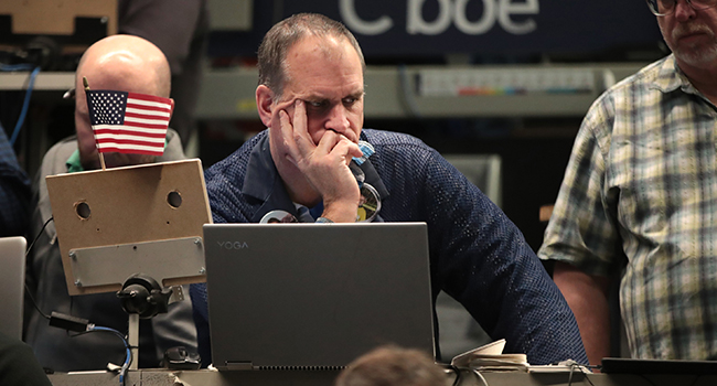 Traders work in the S&P options pit near the close of trading on the Cboe Global Markets trading floor on January 31, 2020 in Chicago, Illinois. Scott Olson/Getty Images/AFP