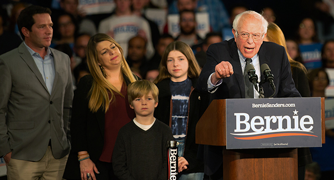 Democratic presidential candidate Vermont Senator Bernie Sanders speaks to supporters as they wait for results to come in at his caucus night watch party on February 3, 2020 in Des Moines, Iowa. Kerem Yucel / AFP