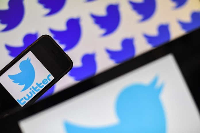 (FILES) In this file photo taken on May 2, 2019 logos of US social network Twitter are displayed on the screen of smartphones, in Nantes, western France. - Twitter staff across the world were asked to work from home starting on March 2, 2020 in an effort to stop the spread of the deadly new coronavirus epidemic. At the same time, thousands of staff at Google's European headquarters in Ireland were told to stay away for the day after one employee reported flu-like symptoms. The outbreak has spread across the world since emerging in central China late last year, killing more than 3,100 people, infecting over 90,000, and prompting a wave of travel restrictions. (Photo by LOIC VENANCE / AFP)