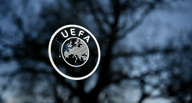(FILES) In this file photo taken on February 28, 2020 shows the UEFA logo at the organization's headquarters in Nyon. Fabrice COFFRINI / AFP