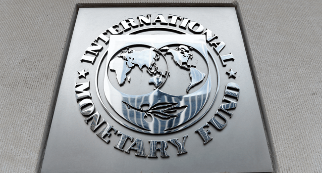 ) In this file photo an exterior view of the building of the International Monetary Fund (IMF), with the IMG logo, is seen on March 27, 2020 in Washington, DC.  Olivier DOULIERY / AFP