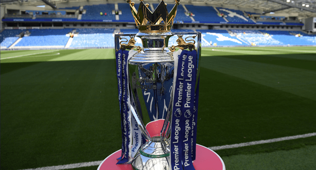 In this file photo taken on August 12, 2017 The Premier league trophy sits beside the pitch ahead of the English Premier League football match between Brighton and Hove Albion and Manchester City at the American Express Community Stadium in Brighton. CHRIS J RATCLIFFE / AFP