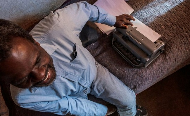 Jetro Gonese and his braille typewriter. South Africa's anti-coronavirus lockdown has had a devastating impact on the visually impaired Luca Sola AFP