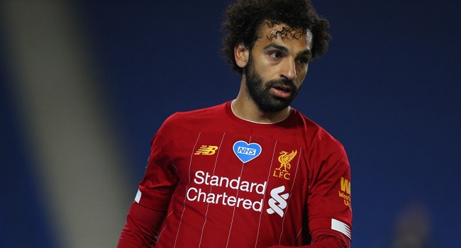 A NHS badge is dislayed on the shirt of Liverpool's Egyptian midfielder Mohamed Salah during the English Premier League football match between Brighton and Hove Albion and Liverpool at the American Express Community Stadium in Brighton, southern England on July 8, 2020. (Photo by Catherine Ivill / POOL / AFP)