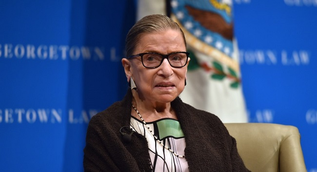 (FILES) In this file photo taken on September 20, 2017 US Supreme Court Justice Ruth Bader Ginsburg looks on as she speaks to first year Georgetown University law students in Washington, DC. - US Supreme Court Justice Ruth Bader Ginsburg, the 87-year-old anchor of its liberal faction, has been discharged from hospital on July 15, 2020 US media reported, after being hospitalized for a suspected infection on July 14. (Photo by Nicholas Kamm / AFP)